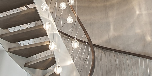 Pendant lamp in staircase and loft